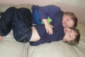 Twin boys hugging