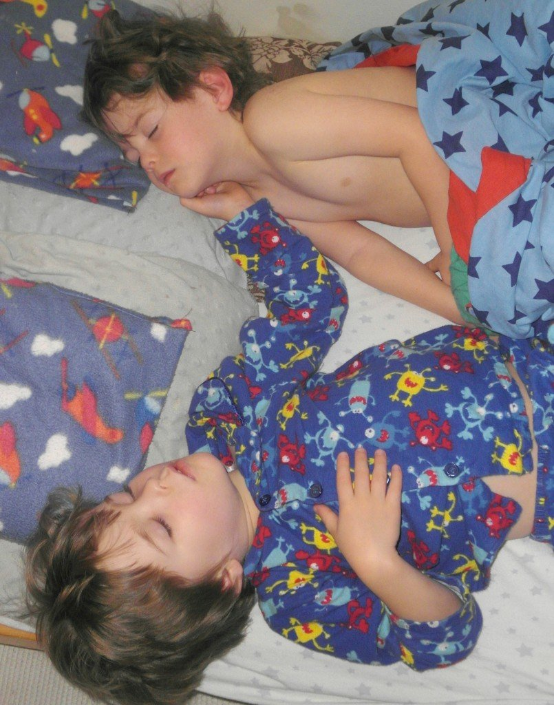 Twins in bed asleep
