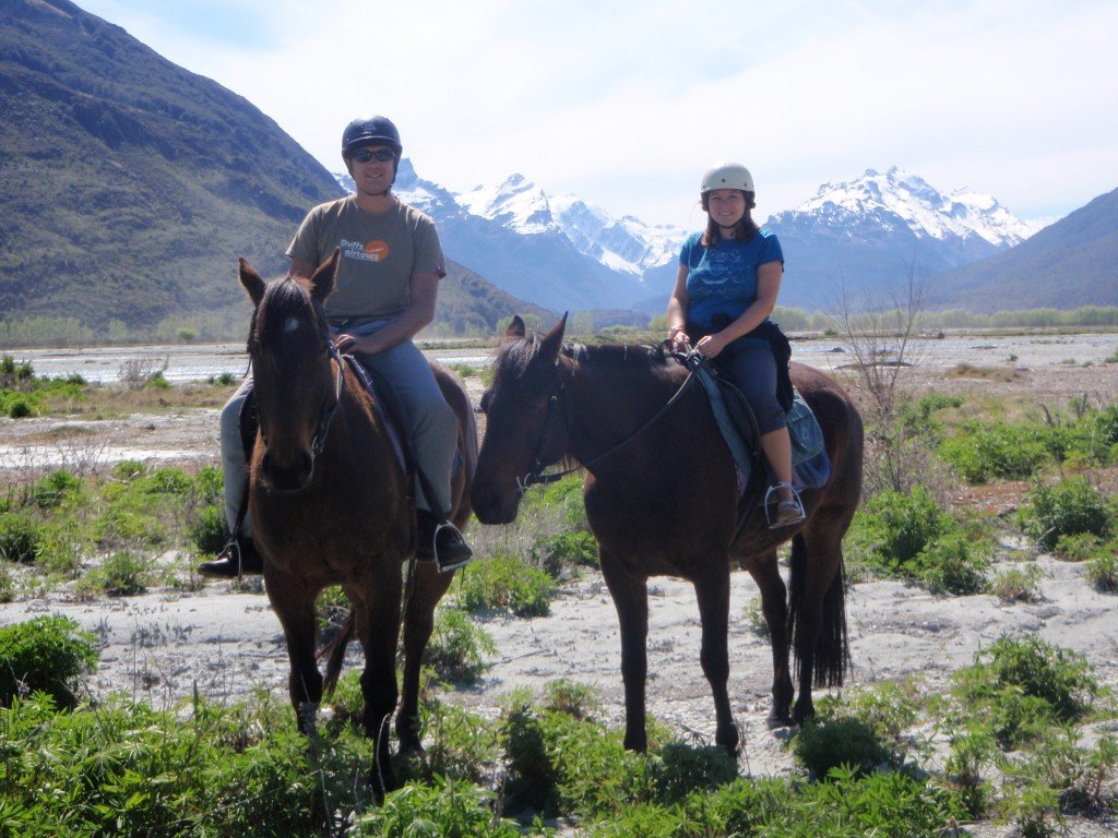 Couple horse riding in New Zealand