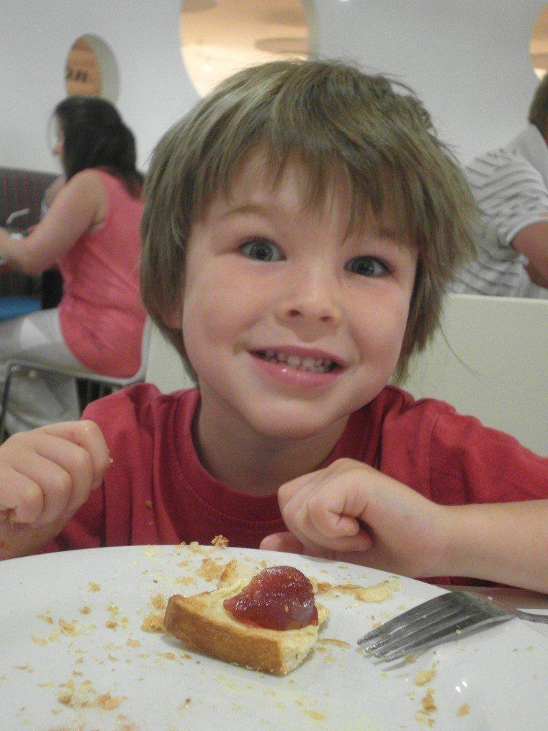 Boy eating toast