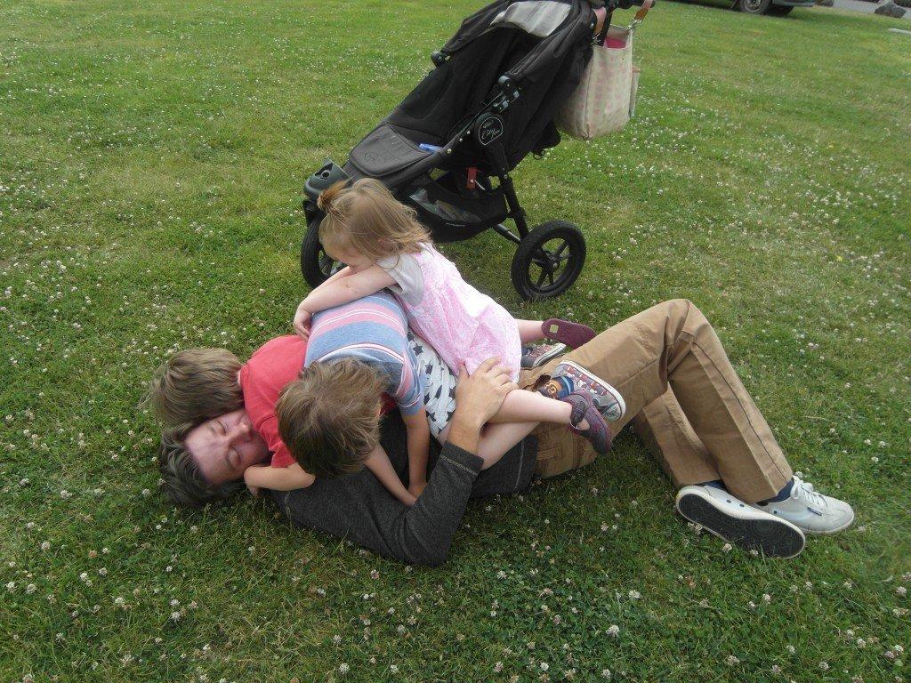 Children climbing on their dad