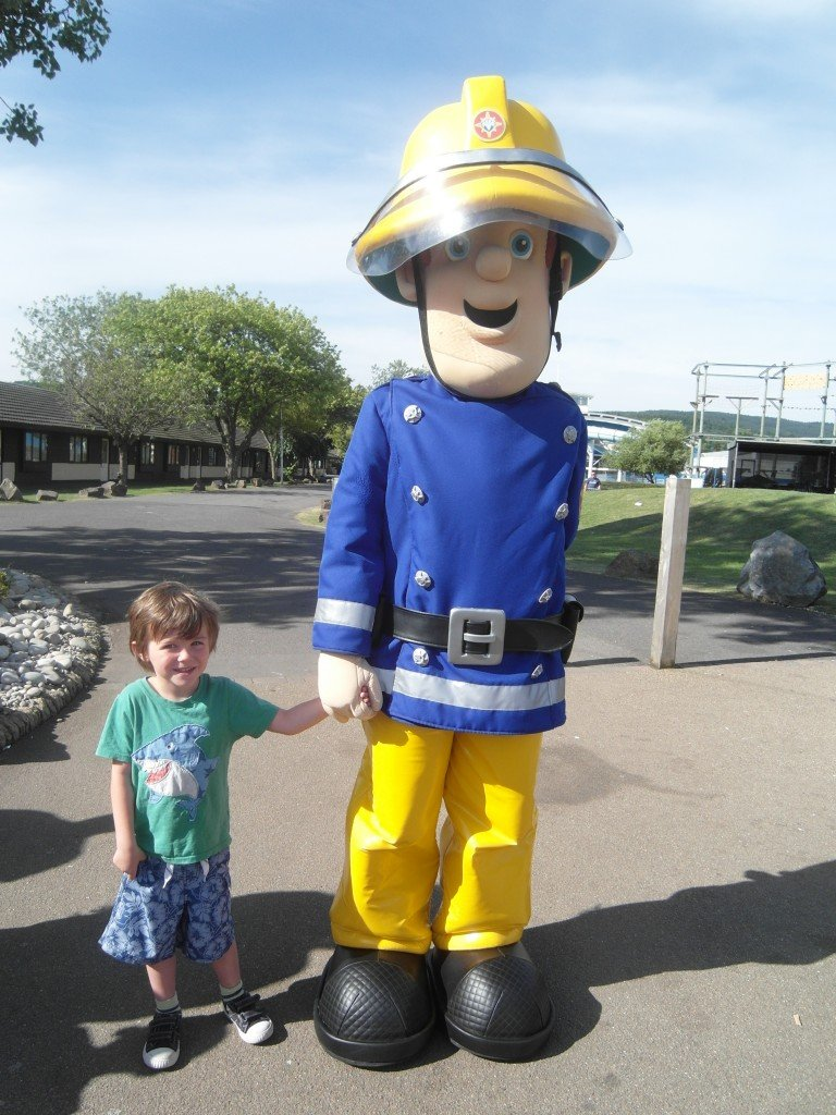 Fireman Sam and a boy.