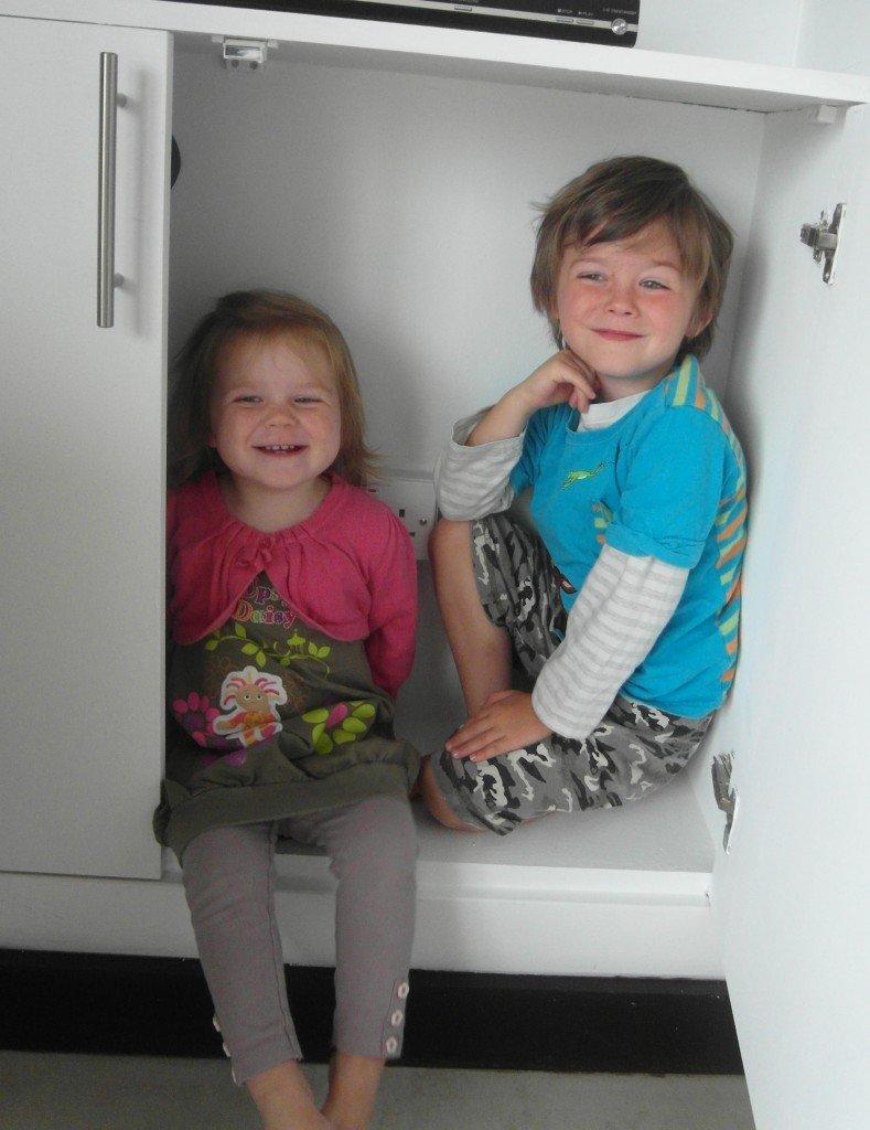 Two children in a cupboard