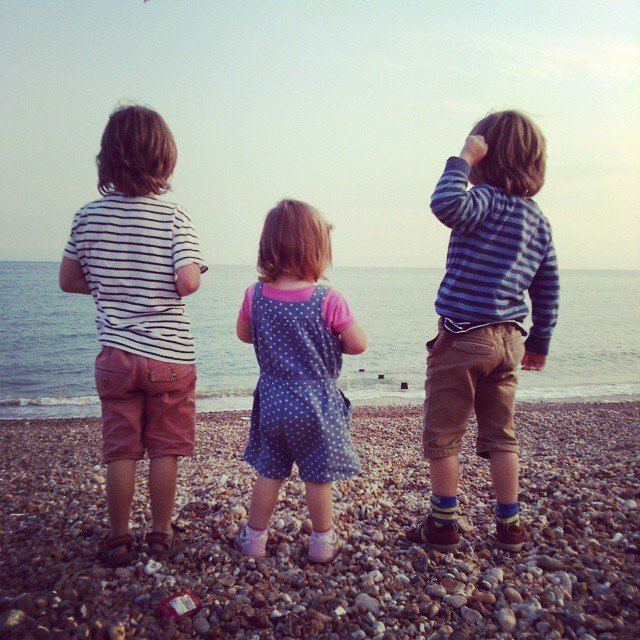 Three children on a beach