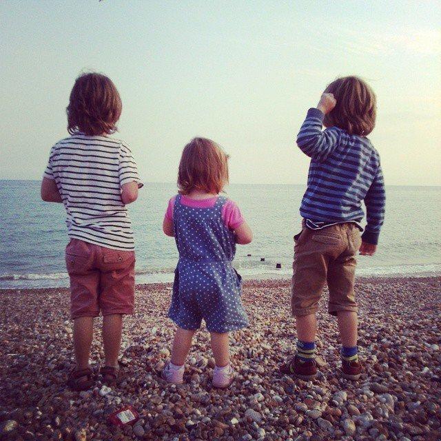 Three children on a beach