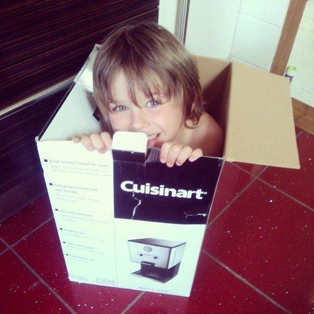A boy hiding in a box