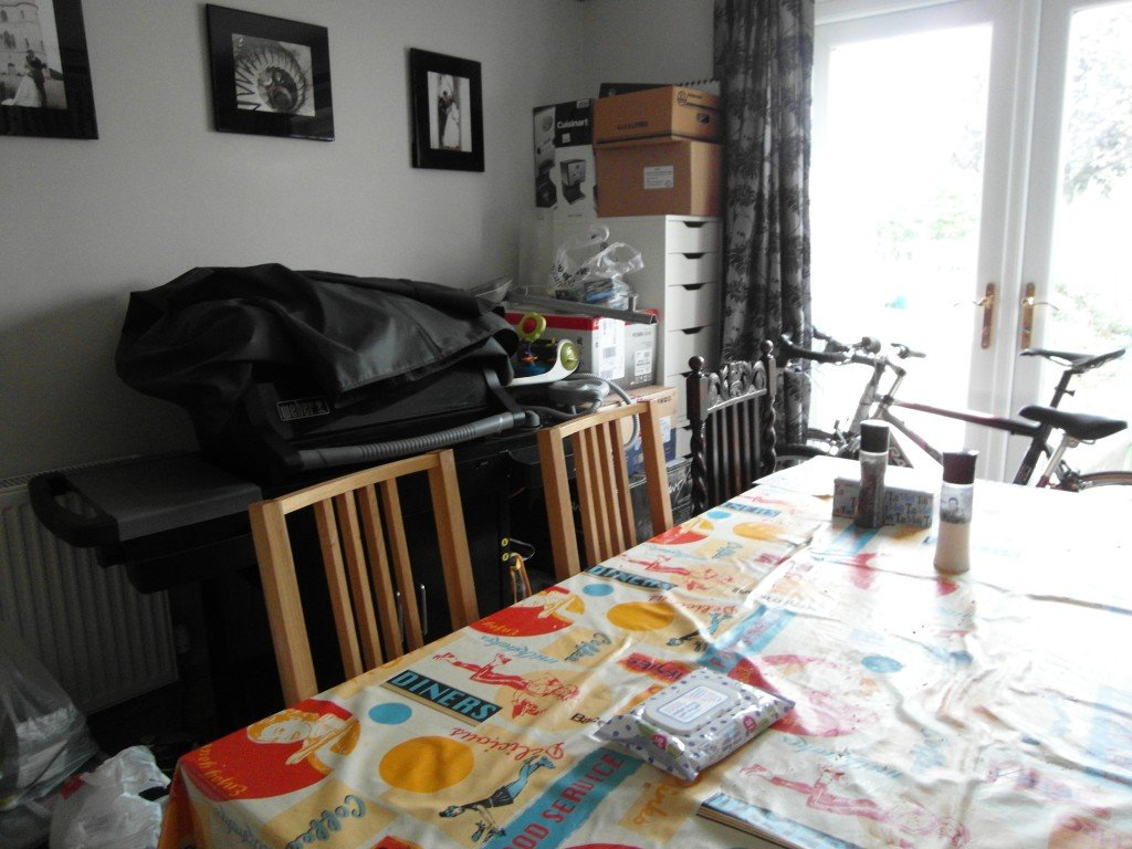 A dining room full of stuff