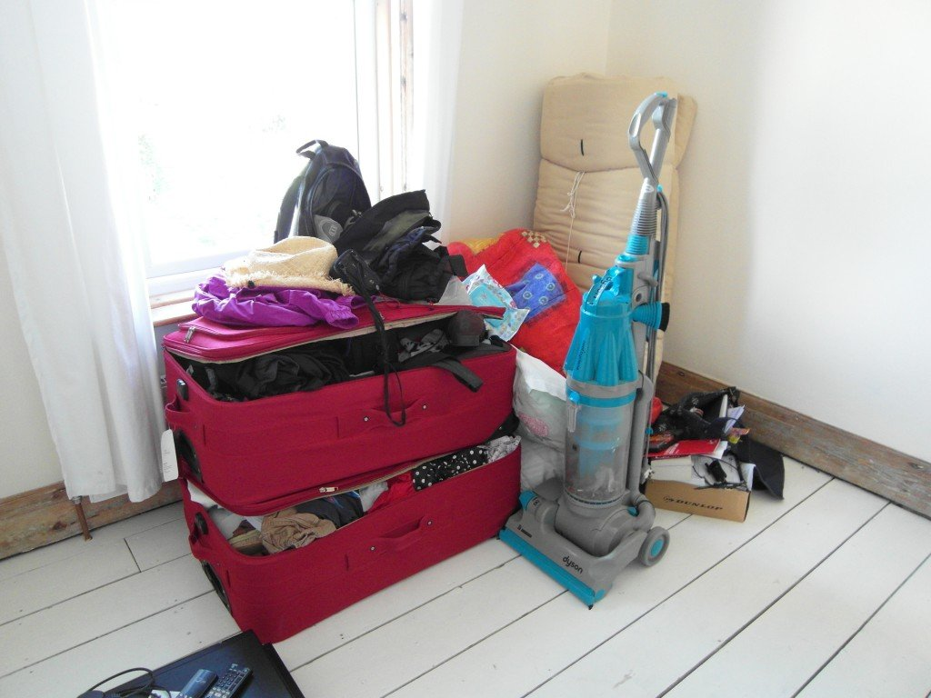 A suitcase and vacuum cleaner