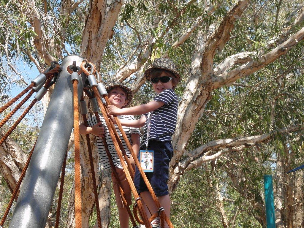 Boys climbing at a park