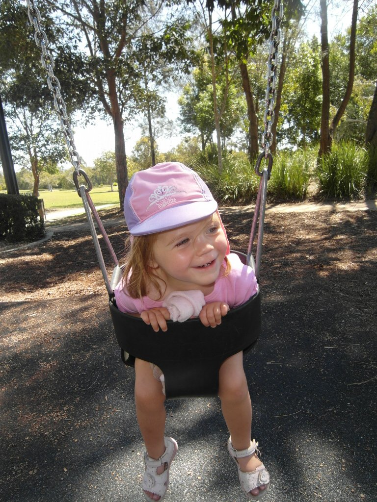 A toddler on a swing