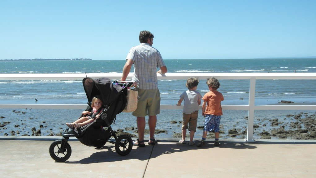 A family looking out to sea