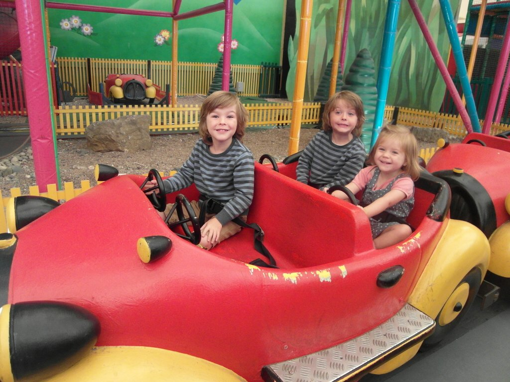 Three kids on a ride