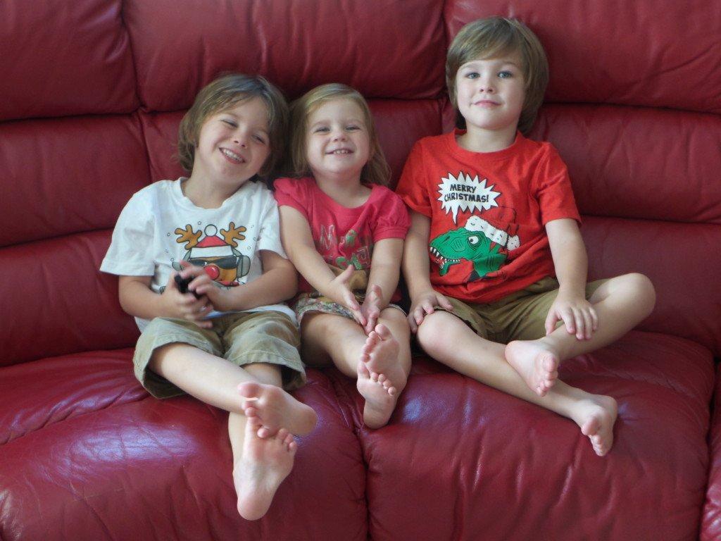 Three children on a sofa