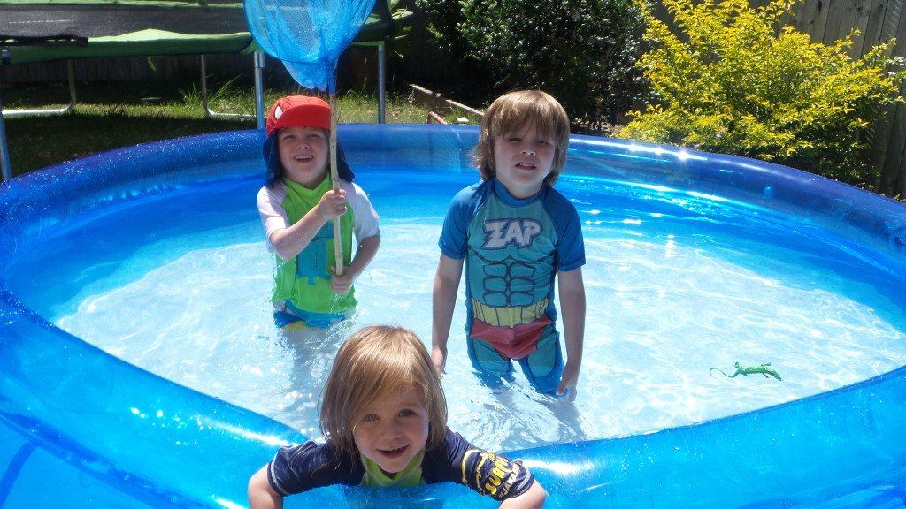 Children in a big paddling pool