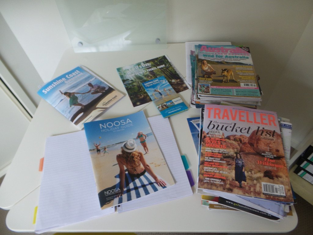 A table of travel magazines and brochures