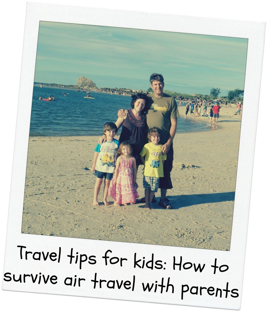 A family on a beach - travel tips for kids