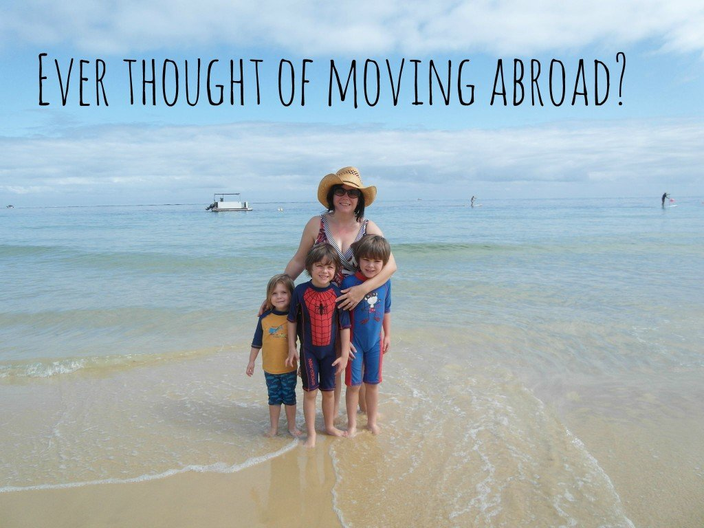 A family on a beach - moving abroad