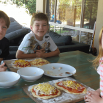 Kids making pizzas to go on the bbq