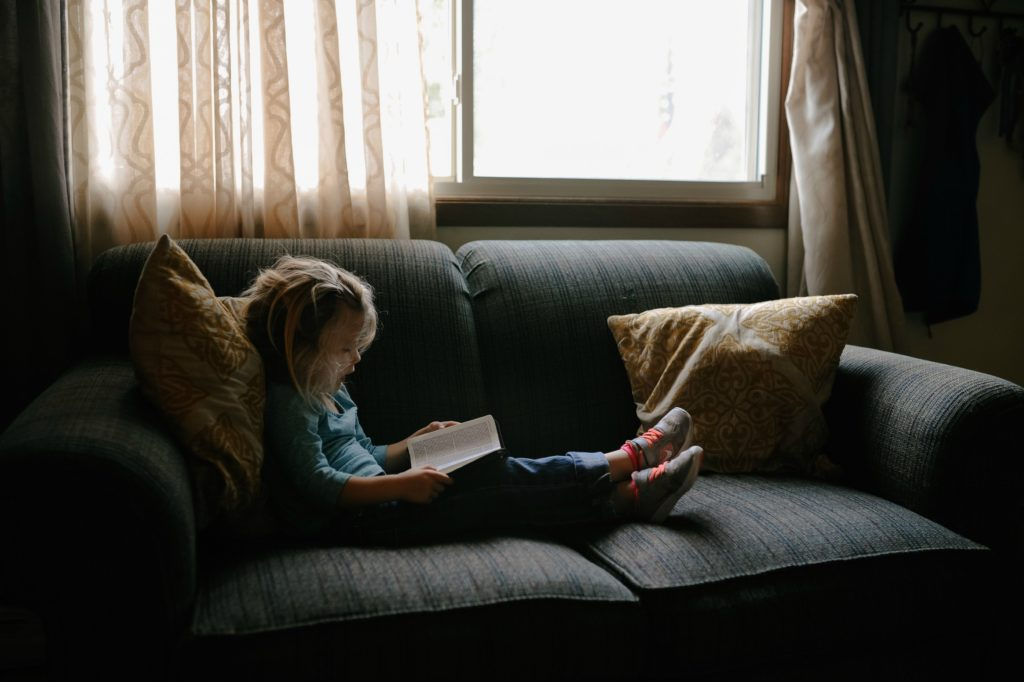 Girl on a sofa - secrets to a calmer, more organised family life