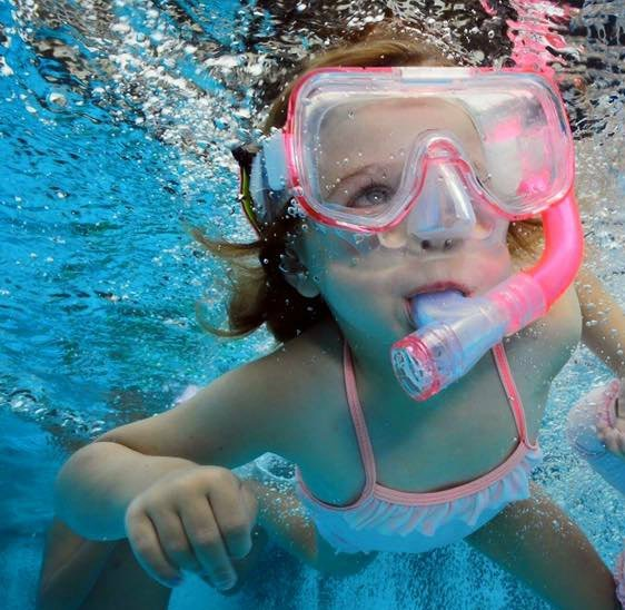 A girl snorkelling on holiday